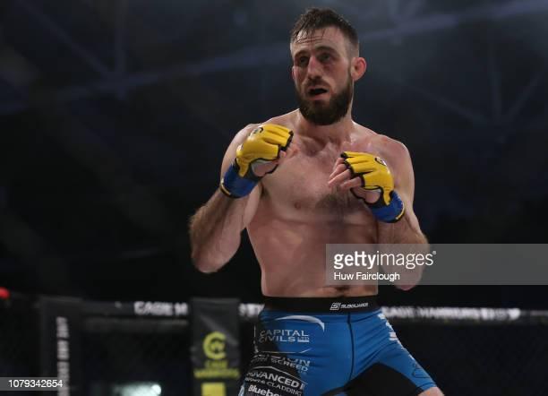 Aiden Lee Black Shortsvs Dean Trueman Featherweight Title Fight In Cage Warriors 100 Dean Trueman on December 8 2018 at the Viola Arena in Cardiff...