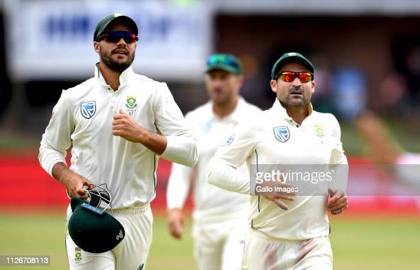 Aiden Markram and Dean Elgar of South Africa runs off the fielding to prepare to bat during day 2 of the 2nd Castle Lager Test match between South...