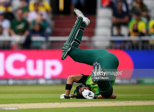 Aiden Markram of South Africa hits the ground to avoid a straight drive from Quinton de Kock of South Africa during the Group Stage match of the ICC...