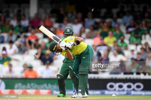 Aiden Markram of South Africa is bowled by Shakib Al Hasan of Bangladesh as Mushfiqur Rahim of Bangladesh watches on during the Group Stage match of...