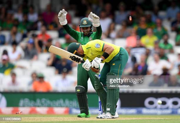 Aiden Markram of South Africa is bowled by Shakib Al Hasan of Bangladesh as Mushfiqur Rahim of Bangladesh celebrates during the Group Stage match of...