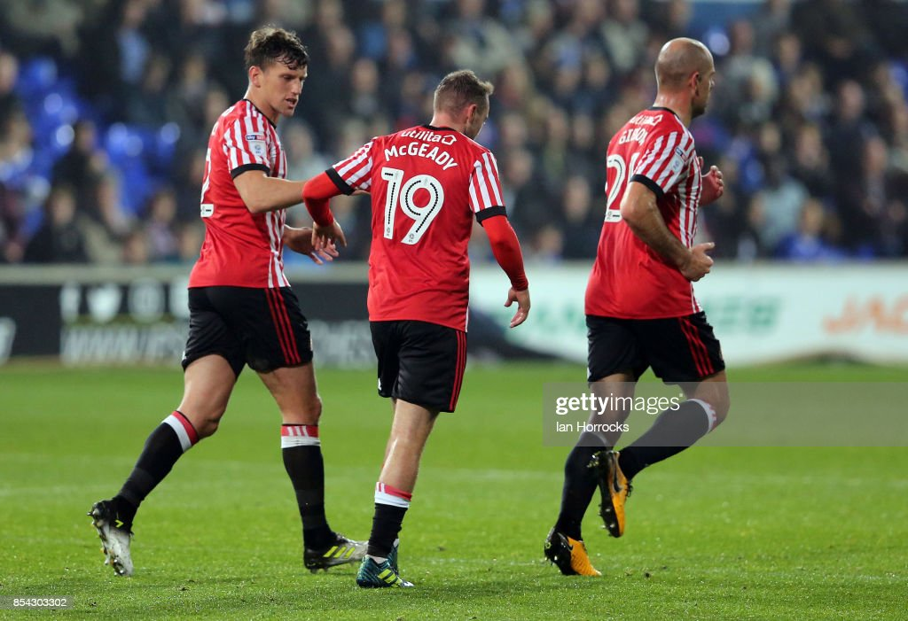 Aiden McGeady celebrates with Billy Jones (L) and Darron Gibson (R) after he scores Sunderland's second goal during the Sky Bet Championship match between Ipswich Town and Sunderland at Portman Road on September 26, 2017 in Ipswich, England.