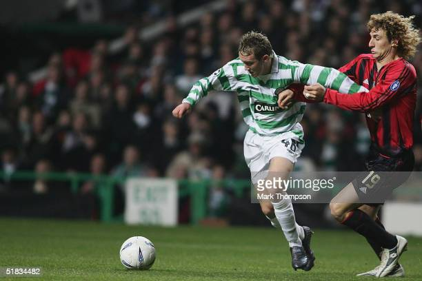 Aiden McGeady of Celtic battles with Fabrico Coloccini of AC Milan during the UEFA Champions League Group F match between Celtic and AC Milan at...