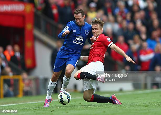 Aiden McGeady of Everton is challenged by Luke Shaw of Manchester United during the Barclays Premier League match between Manchester United and...