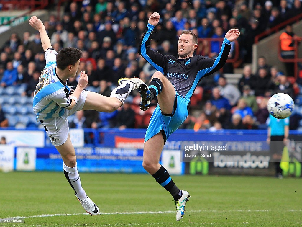 Aiden McGeady of Sheffield Wednesday FC and Joe Lolley of Huddersfield Town FC compete for the ball during the Sky Bet Championship match between Huddersfield Town and Sheffield Wednesday at Galpharm Stadium on April 2, 2016 in Huddersfield, United Kingdom.