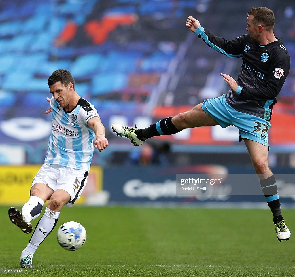 Aiden McGeady of Sheffield Wednesday FC leaps to attempt smothering a pass from Mark Hudson (C) of Huddersfield Town FC during the Sky Bet Championship match between Huddersfield Town and Sheffield Wednesday at Galpharm Stadium on April 2, 2016 in Huddersfield, United Kingdom.