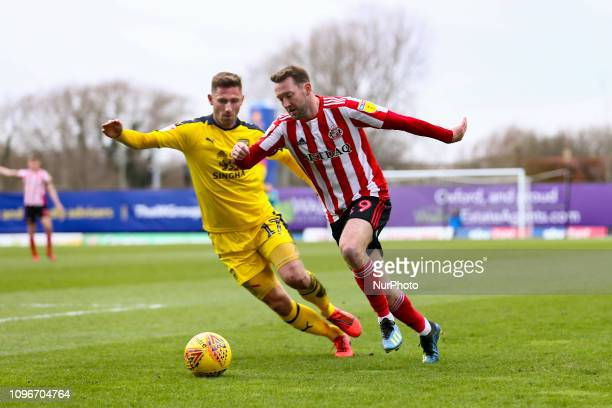 Aiden McGeady of Sunderland and James Henry of Oxford United during the Sky Bet League 1 match between Oxford United and Sunderland at the Kassam...
