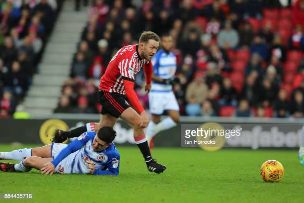 Aiden McGeady of Sunderland competes with Liam Kelly of Reading during the Sky Bet Championship match between Sunderland and Reading at Stadium of...