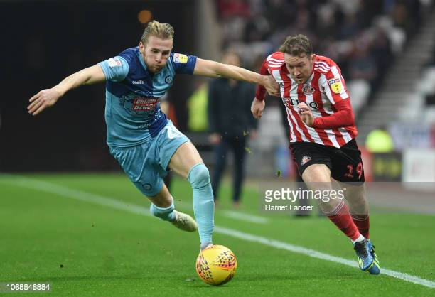 Aiden McGeady of Sunderland is challenged by Jason McCarthy of Wycombe Wanderers during the Sky Bet League One match between Sunderland and Wycombe...