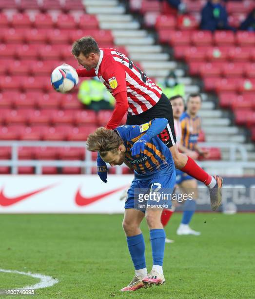Aiden McGeady of Sunderland rides on the back of Harry Chapman of Shrewsbury during the Sky Bet League One match between Sunderland and Shrewsbury...