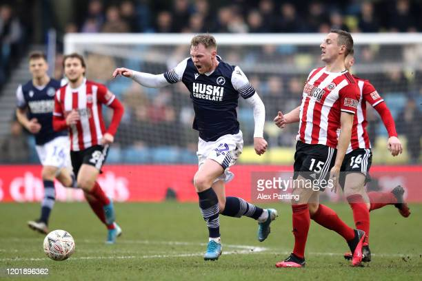 Aiden O'Brien of Millwall is tackled by Phil Jagielka of Sheffield United during the FA Cup Fourth Round match between Millwall and Sheffield United...