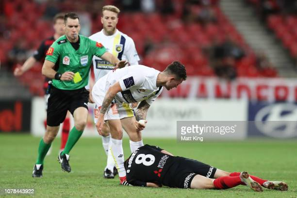 Aiden O'Neill of the Mariners is given a yellow card after fouling Jordan O'Doherty of the Wanderers during the round seven ALeague match between the...