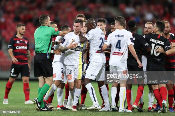 Aiden O'Neill of the Mariners scuffles with Wanderers players after fouling Jordan O'Doherty of the Wanderers during the round seven ALeague match...