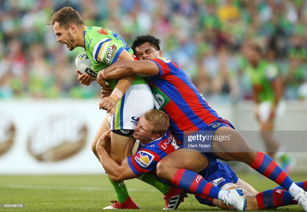 Aiden Seizer of the Raiders is tackled during the round two NRL match between the Canberra Raiders and the Newcastle Knights at GIO Stadium on March 18, 2018 in Canberra, Australia.