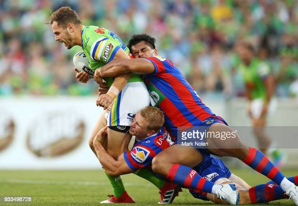 Aiden Seizer of the Raiders is tackled during the round two NRL match between the Canberra Raiders and the Newcastle Knights at GIO Stadium on March...