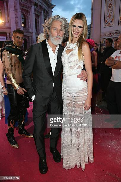Aiden Shaw and model attend the 'Life Ball 2013 Magenta Carpet Arrivals' at City Hall on May 25 2013 in Vienna Austria