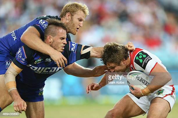 Aiden Tolman and Josh Reynolds of the Bulldogs tackle Mitch Rein of the Dragons during the round six NRL match between the St George Illawarra...