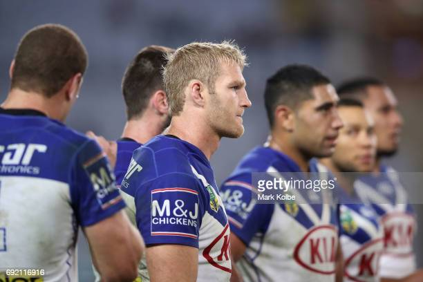 Aiden Tolman of the Bulldogs and his team look dejected after a Panthers try during the round 13 NRL match between the Canterbury Bulldogs and the...