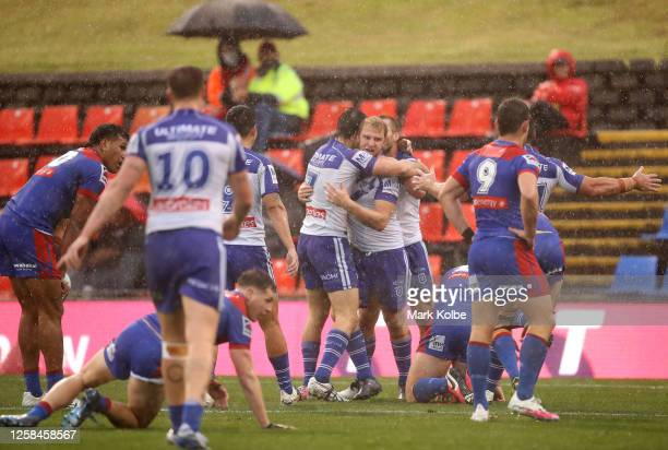 Aiden Tolman of the Bulldogs celebrates after scoring a try during the round 11 NRL match between the Newcastle Knights and the Canterbury Bulldogs...