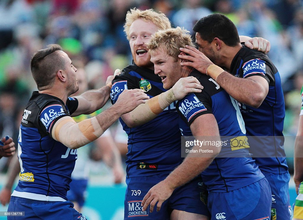 Aiden Tolman of the Bulldogs is congratulated by team mates after scoring a try during the round 12 NRL match between the Canberra Raiders and the Canterbury Bulldogs at GIO Stadium on May 29, 2016 in Canberra, Australia.