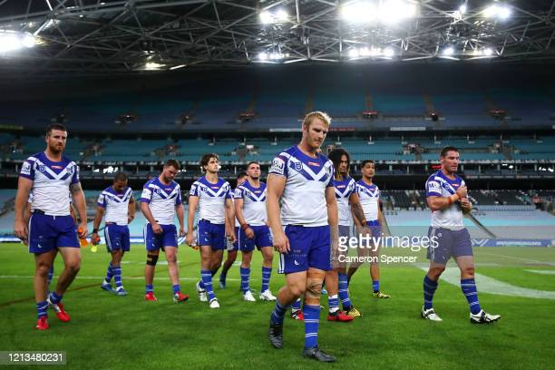 Aiden Tolman of the Bulldogs of the Bulldogs and team mates leave the field after losing the round 2 NRL match between the Canterbury Bulldogs and...