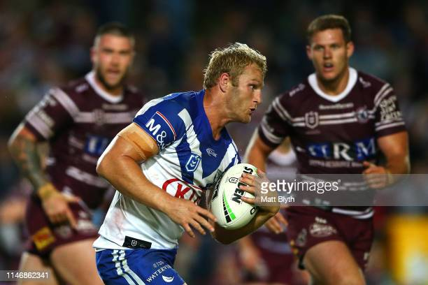 Aiden Tolman of the Bulldogs runs the ball during the round eight NRL match between the Manly Warringah Sea Eagles and the Canterbury Bulldogs at...