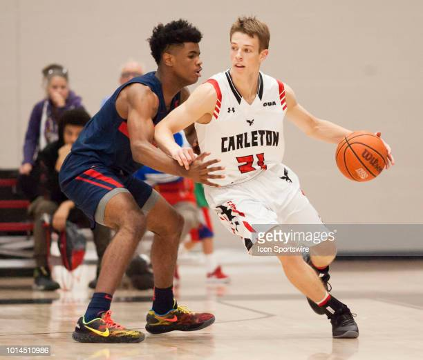 Aiden Warnholtz of the Carleton University Ravens drives around an Ole Miss defender in preseason college basketball play at Carleton University's...