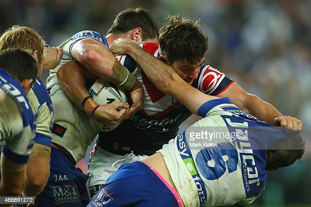 Aidern Guerra of the Roosters fends away Josh Reynolds of the Bulldogs during the First NRL Semi Final match between the Sydney Roosters and the...