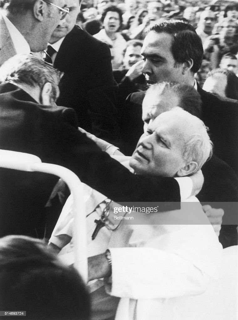 Aides hold Pope John Paul II after being shot by a terrorist. The Pope later recovered from his wounds.