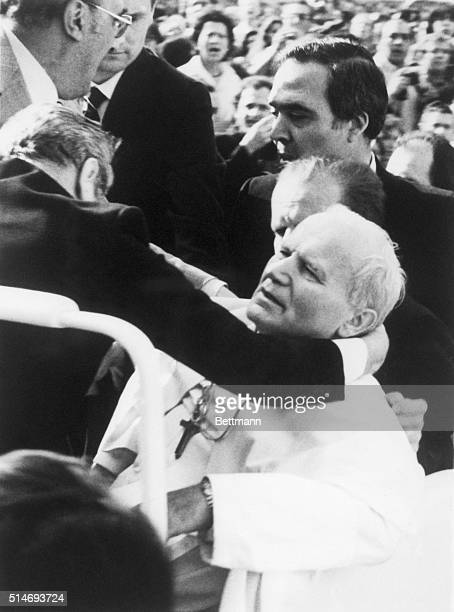 Aides hold Pope John Paul II after being shot by a terrorist The Pope later recovered from his wounds
