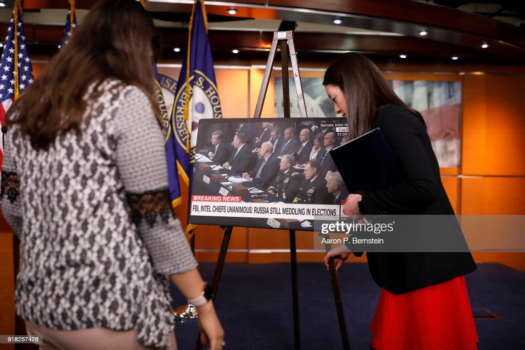 Aides place a sign ahead of House Minority Leader Nancy Pelosi speaking at a press conference on Capitol Hill on February 14, 2018 in Washington, DC. Pelosi and her fellow Democrats addressed the need for heightened security surrounding the nation's voting systems ahead of the 2018 midterms.