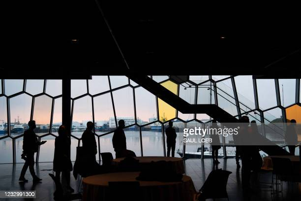 Aides to US Secretary of State Antony Blinken and Russian Foreign Minister Sergey Lavrov wait outside their meeting room at the Harpa Concert Hall in...