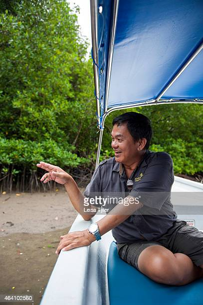 Aidi Abdullah a naturalist at the Four Seasons Langkawi Resort pointing out mud skippers at Kilim Karst Geoforest Park in Langkawi an island in north...