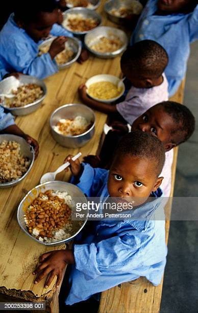 Aids orphans eat lunch in hospital in Murchison, South Africa