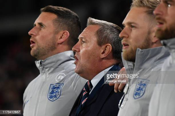 Aidy Boothroyd manager of England sings the national anthem prior to the UEFA European U21 2021 Championship Qualifier between England and Kosovo at...