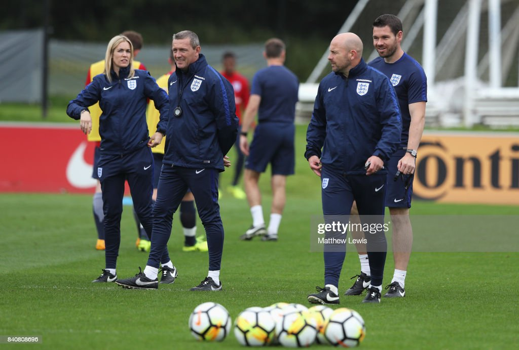 Aidy Boothroyd (2ndL), manager of England talks with Lee Carsley (2ndR) during an England Under 21 training session at St George's Park on August 30, 2017 in Burton-upon-Trent, England.