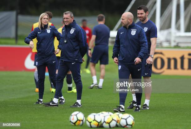 Aidy Boothroyd manager of England talks with Lee Carsley during an England Under 21 training session at St George's Park on August 30 2017 in...