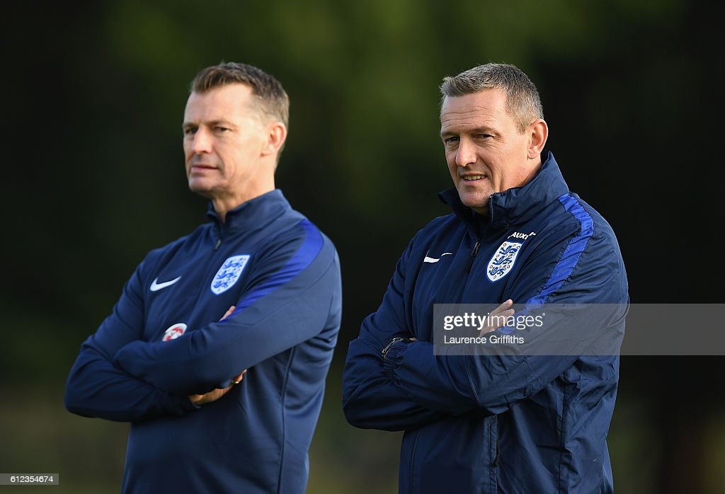 Aidy Boothroyd of England U-21 looks on with Colin Cooper during a training session at St Georges Park on October 4, 2016 in Burton-upon-Trent, England.