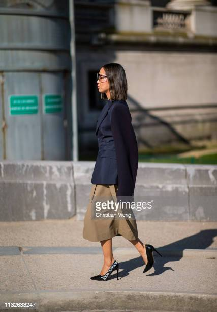 Aiee Song is seen weairng beige skirt navy blazer outside Maison Margiela during Paris Fashion Week Womenswear Fall/Winter 2019/2020 on February 27...