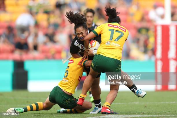 Aieshaleigh Smalley of the Ferns is tackled during the 2017 Rugby League Women's World Cup Final between Australia and New Zealand at Suncorp Stadium...