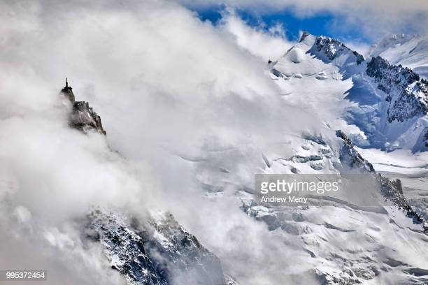aiguille du midi summit, peak in the clouds - pinnacle peak stock pictures, royalty-free photos & images