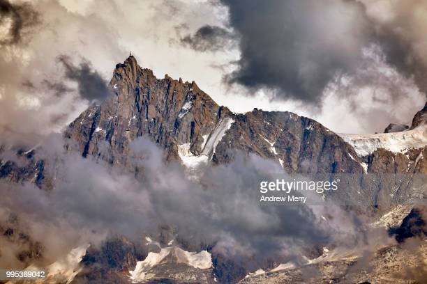 aiguille du midi summit, peak, mountain range with dramatic clouds - pinnacle peak stock-fotos und bilder