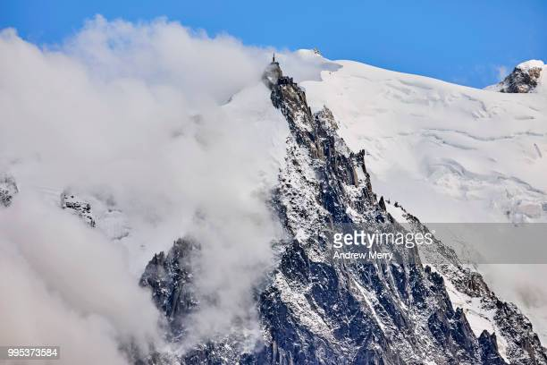 aiguille du midi summit, peak, triangle shaped with clouds and blue sky - pinnacle peak stock pictures, royalty-free photos & images
