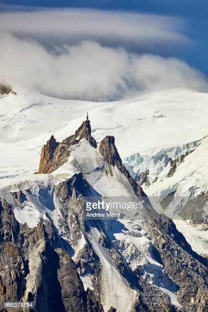 aiguille du midi summit, peak with glacier, snow and clouds - pinnacle peak stock-fotos und bilder