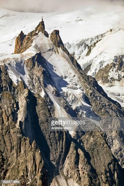 aiguille du midi summit, peak with snow and eroded rock - pinnacle peak stock-fotos und bilder