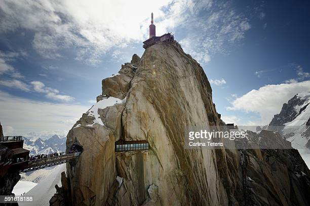 aigulle de midi peak with bridge and viewing areas on a sunny day - blanche vallee stock photos and pictures