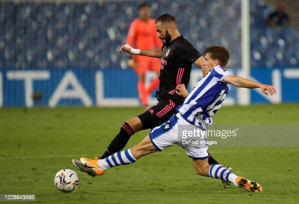 Aihen Munoz of Real Sociedad and Karim Benzema of Real Madrid battle for the ball during the La Liga Santader match between Real Sociedad and Real...
