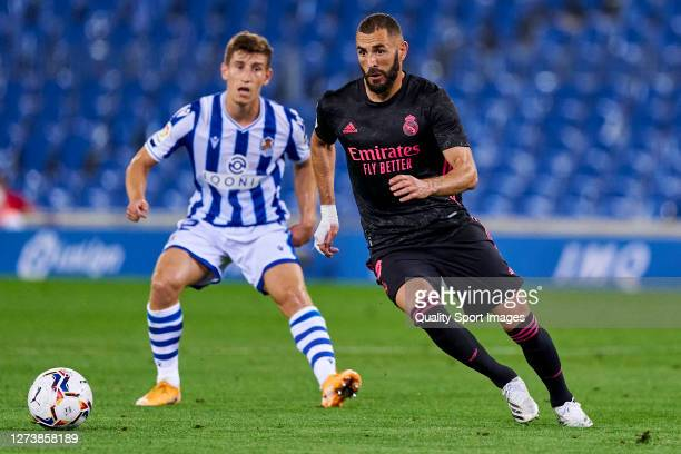 Aihen Muñoz of Real Sociedad battle for the ball with Karim Benzema of Real Madrid during the La Liga Santader match between Real Sociedad and Real...