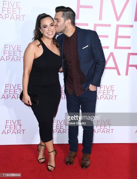 Aijia Lise and Andy Grammer arrive at the Premiere of Lionsgate's 'Five Feet Apart' at Fox Bruin Theatre on March 07 2019 in Los Angeles California