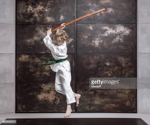Aikido Boy. Training Fight Using Wooden Bokken